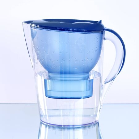 Water filter on a light background photo