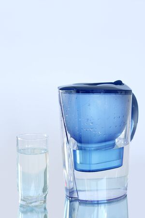 jugs: Water filter on a light blue background Stock Photo
