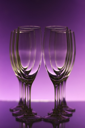 Empty champagne glasses on purple background Stock Photo - 8534704