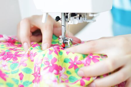 Fabric in a sewing machine photo