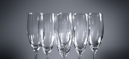Empty champagne glasses on gray background photo
