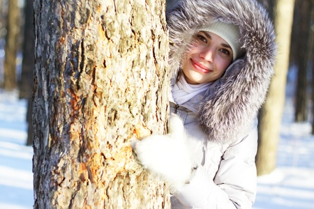 girl winter portrait on background of trees photo