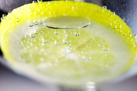 carbonated: Lemon and drops of carbonated water Stock Photo