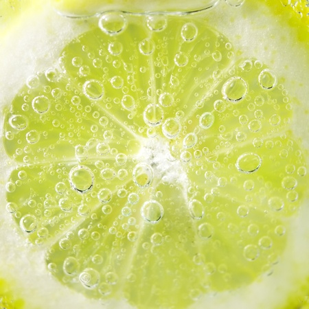 carbonated drink: Lemon and drops of carbonated water Stock Photo