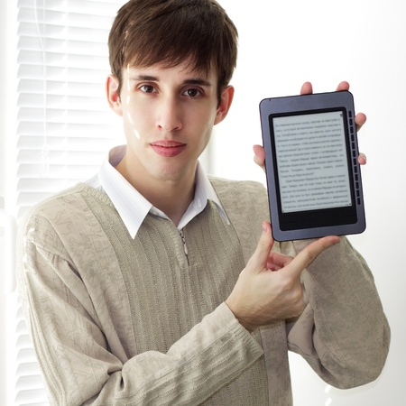 Student with ebook reader on a light background photo