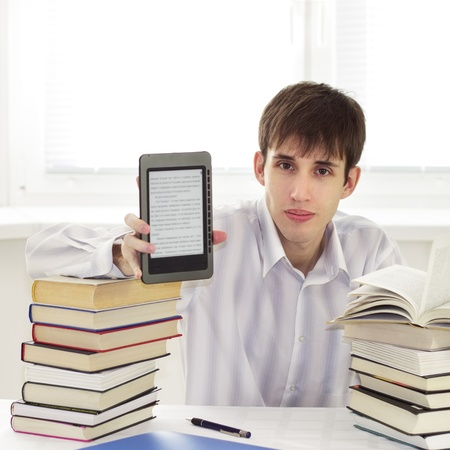 Student with ebook reader on a light background Stock Photo - 8632794