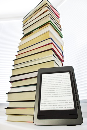 Ebook reader on a light background window photo
