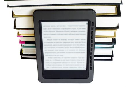 Ebook reader on pile of ordinary books Stock Photo