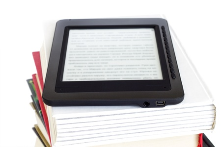 e book reader: Ebook reader on pile of ordinary books Isolated on white background Stock Photo