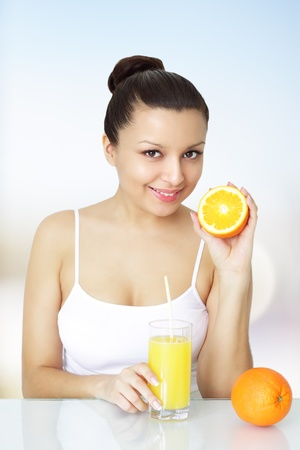 Girl with fresh orange juice photo