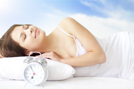 Girl with Alarm Clock on a light background Stock Photo - 9230518