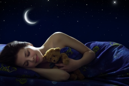 Girl sleeping at night on background of the moon Stock Photo
