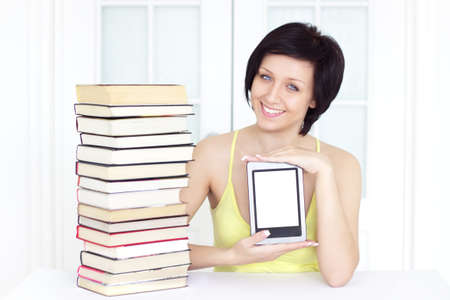 young woman with ebook on a light background photo