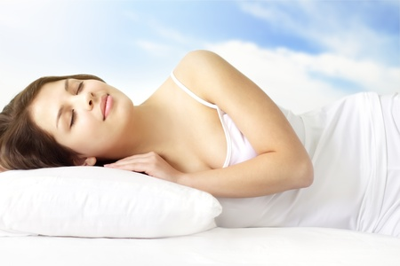 Girl Sleeping on white bed
