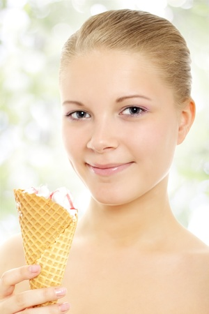 Girl with ice cream on a light background Stock Photo - 9731967