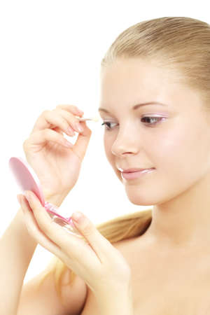 Teenage Girl Applying Make Up Stock Photo - 9731961