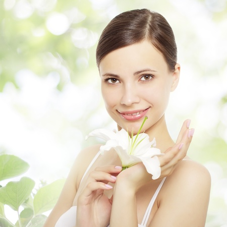 lilly: Beautiful girl with lily flower on a green background Stock Photo