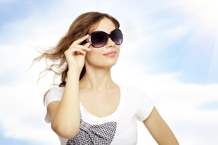 young lady with sunglasses. Sky background Stock Photo