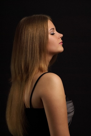 Girl with beauty long hair on black background Stock Photo - 9823986