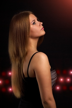 elegant young woman on a dark background Stock Photo - 9823981