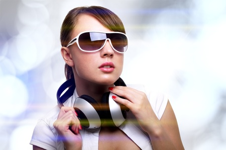 sexy headphones: Girl with headphones on bright background