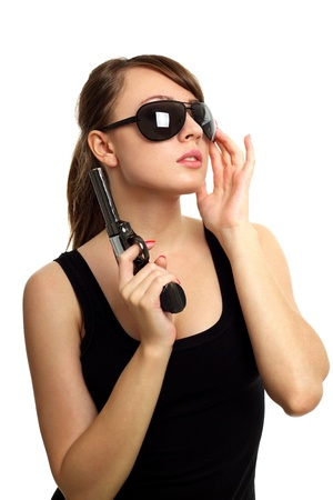 Young woman with gun isolated on white background Stock Photo - 9824186