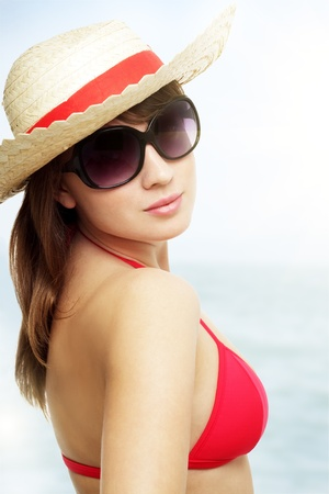 Young woman wearing sunglasses on a light background Stock Photo - 9824223