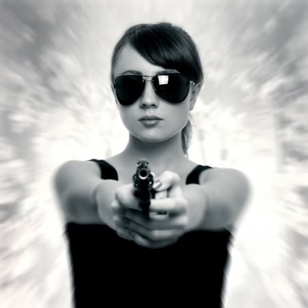 female cop: Young woman with gun. retro style Stock Photo