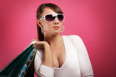 Stylish Girl with shopping bags on red background Stock Photo - 9824222