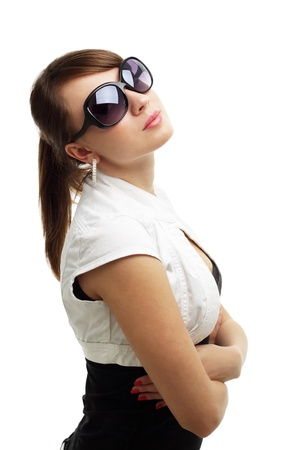 Young woman wearing sunglasses isolated on white photo