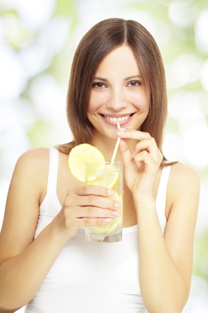 girl holding a lemonade on a light background photo