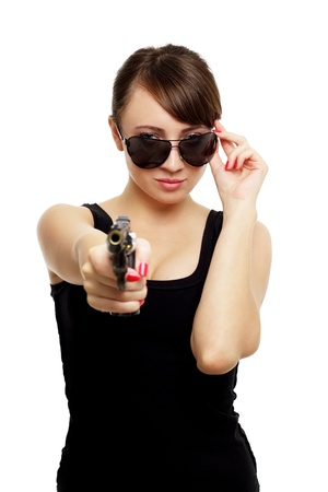 Young woman with gun isolated on white background photo