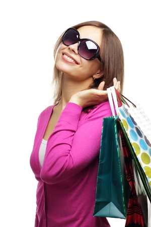 Stylish Girl with shopping bags isolated on white photo