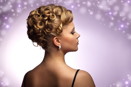 Modern wedding hairstyle. purple background photo