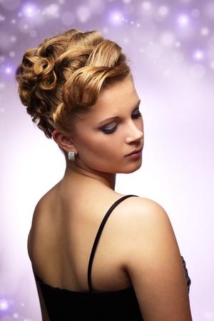 Modern hairstyle. purple background photo