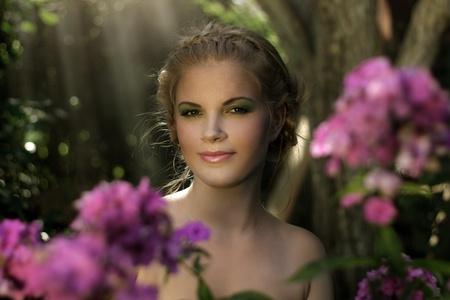 girl in the garden on dark background photo