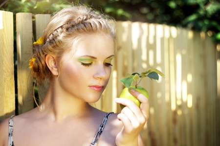 Young woman holding a green apple photo