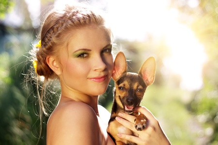 Portrait of a beautiful girl with Miniature Pinscher photo