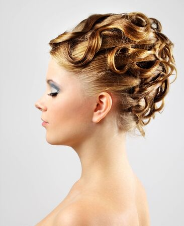 Modern wedding hairstyle. on gray background photo