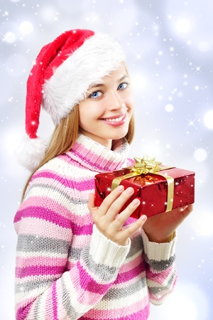 girl with a Christmas box on a blue background photo