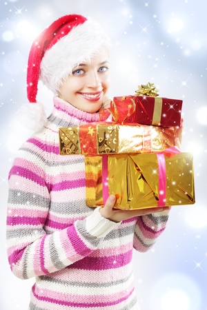 Santa girl with Christmas gifts on a light background photo