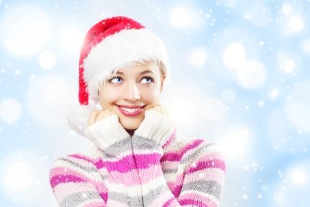 Santa girl on a light background photo
