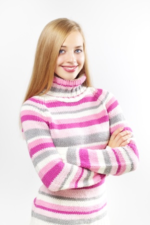 Portrait of pretty girl wearing sweater on a light background