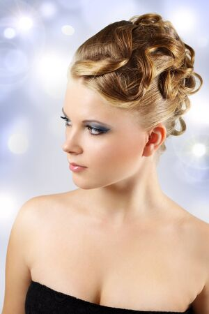 Girl with beautiful hairstyle on a light background photo
