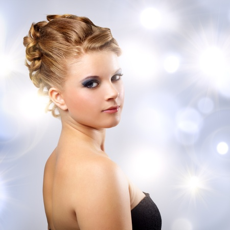 Girl with beautiful hairstyle on a light background Stock Photo - 10698244