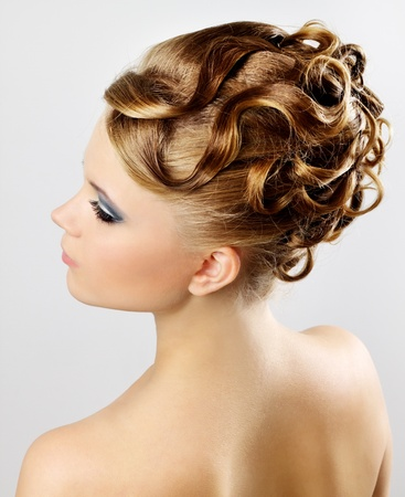 Modern hairstyle. On a gray background photo