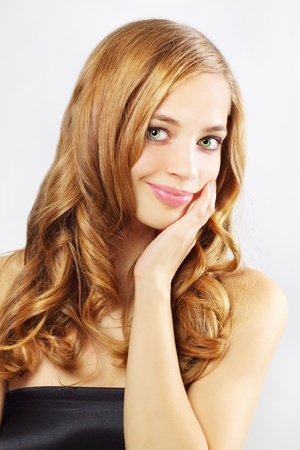 nude blonde girl: Beautiful girl with long wavy hair on a gray background Stock Photo