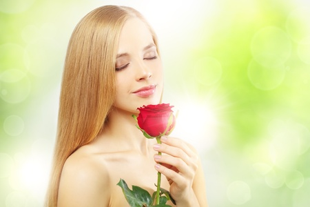 beautiful girl with red rose on a green background