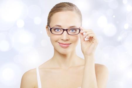 Girl wearing eyeglasses. Light blue background Stock Photo