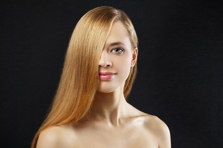Attractive girl with beautiful, straight hair on a dark background Stock Photo - 10798403